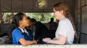 volunteer talking about child safety with students in Cambodia