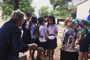 Preparing breakfast at Helping Hands