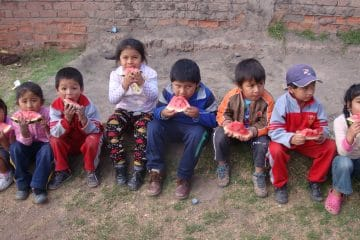 Kids eating their healthy snack in Peru