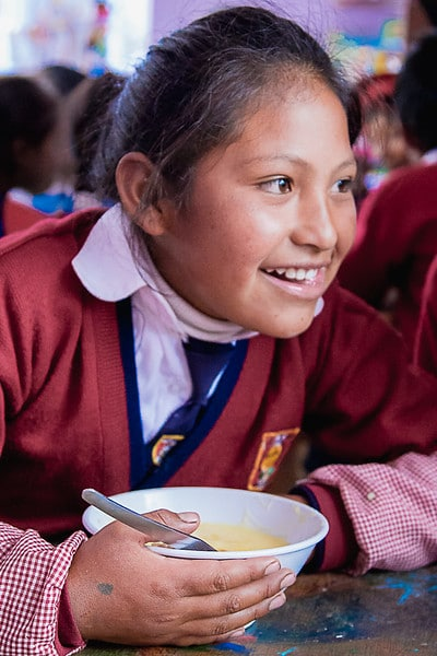 providing nutritious lunch for student at kids project cusco peru