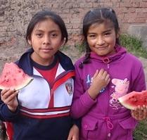 Students at Picaflor House enjoying Watermelon
