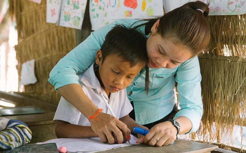 Helping Hands Cambodia Teacher and Student