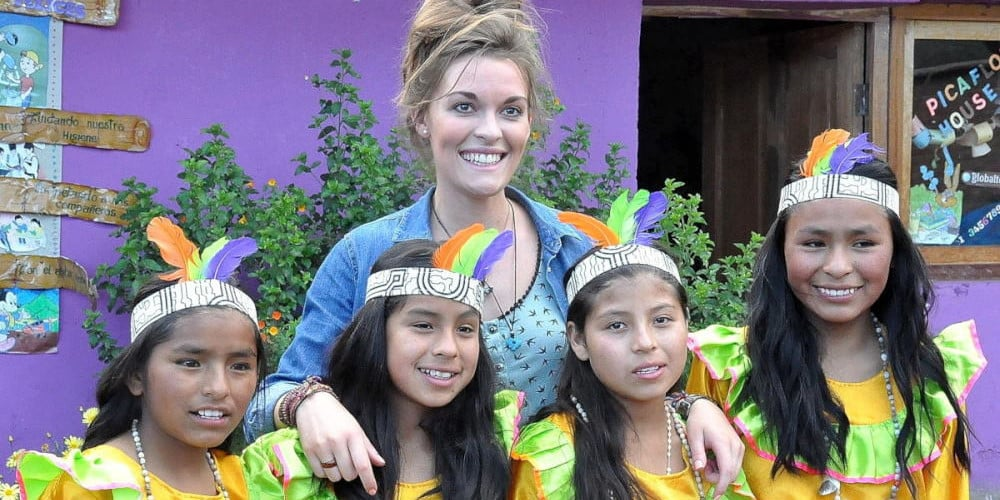 Volunteer with the kids at a traditional dance class