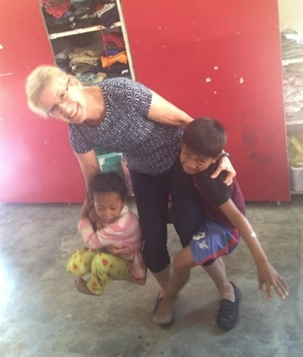 Children playing with volunteer at the Cambodia Community Project