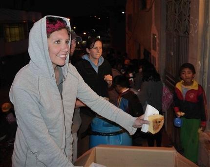 volunteers helping with a chocolatada in Peru