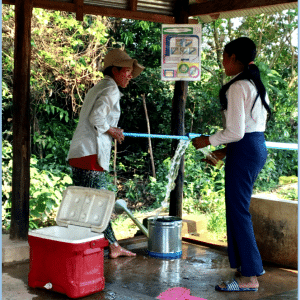 Helping Hands Cambodia Students Pump Well Water