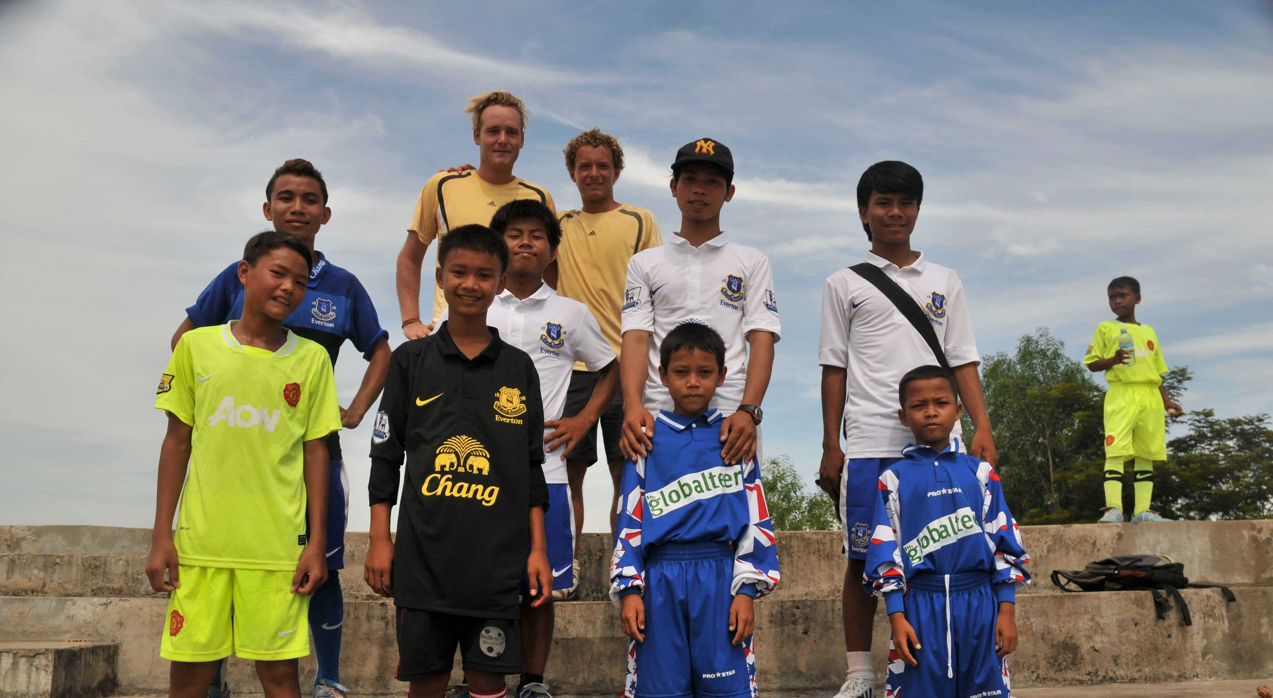 Volunteer helping with kids sports Cambodia