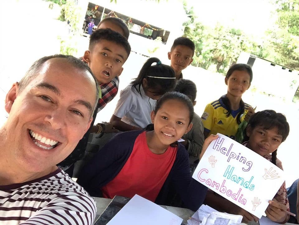 Darron with Helping Hands students.