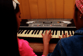 student practising piano at kids project in Cusco Peru