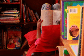 Student reading at free community library project in Cusco Peru