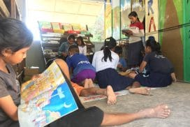 children reading at free kids library project in Peru