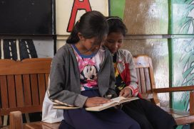 students reading free books provided at kids community project in Siem Reap Cambodia