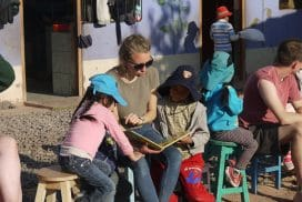 reading to children at kids volunteer project cusco peru