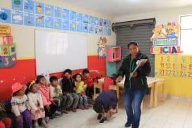 kindergarten students being read to at children's project cusco peru