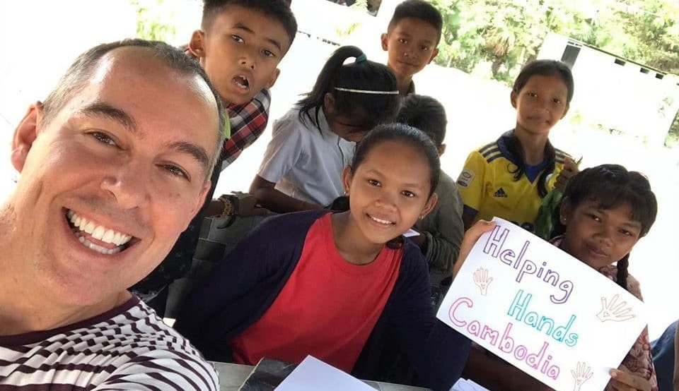 fundraising photo of a volunteer and Cambodian children