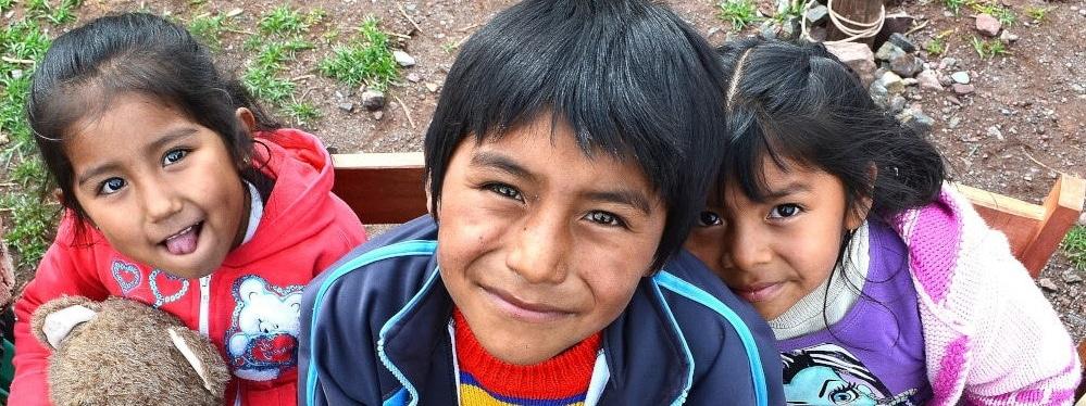 Three children in rural Peru attending Globalteer's supplementary education project